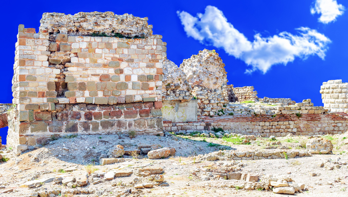 ruins of the old walls of the ancient city on a background of blue sky