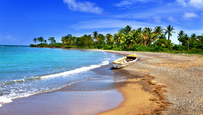 Jamaica. A national boat on the sandy coast of a bay.