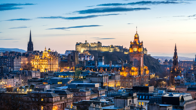 Skyline of Edinburgh at sunset with HDR processing. Cityscape include Edinburgh Castle, Balmoral Hotel Clock Tower and the Scott monument.