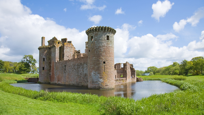 Moated Caerlaverock Castle, Scotland, green, fresh, grass, water, moat, historic, building, old, stone, red, blue, sky, clouds, tourist attraction, tower, round
