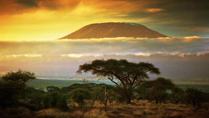 Clouds line around Mount Kilimanjaro at sunset.