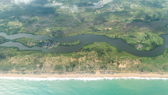 Aerial view of the Atlantic Ocean coastline along the shores of Cotonou, Benin.