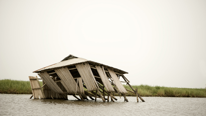 Collapsed stilt house on the lagoon of Ganvie in Benin.