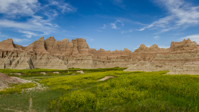 Beautiful springtime landscape of the Badlands with green Spring grass.