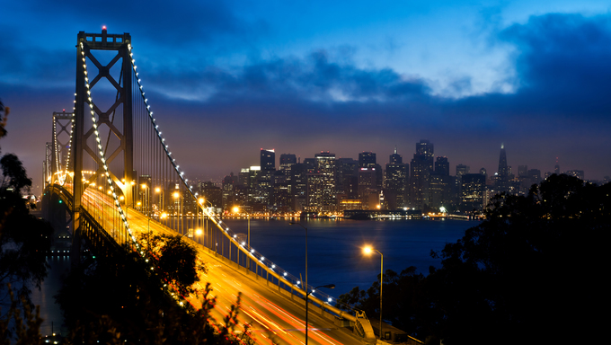 Bay Bridge and San Francisco city view at night.