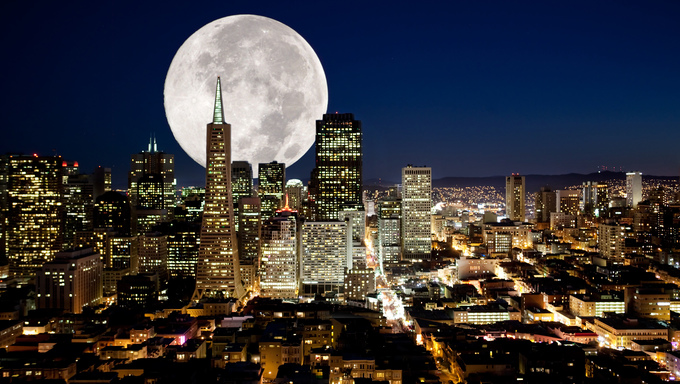 A full moon over an urban metropolis.