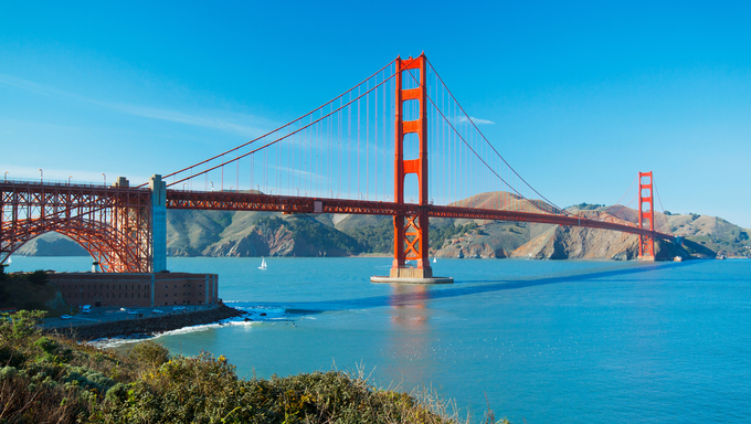 The Golden Gate Bridge in San Francisco with the beautiful blue ocean in background.