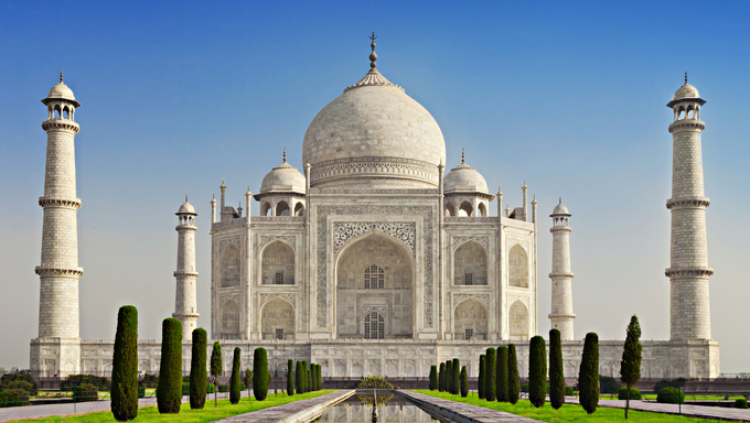 The Taj Mahal is a white marble mausoleum located on the southern bank of the Yamuna River in Agra, India. It was commissioned in 1632 by the Mughal emperor Shah Jahan to house the tomb of his favorite wife of three, Mumtaz Mahal.
