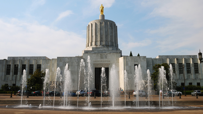 "Oregon State Capitol building built in 1938, atop the marble dome sits ""Gold Pioneer"" in late summer in Salem, Oregon."