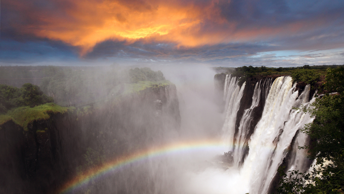 Victoria Falls featuring an outstanding rainbow.