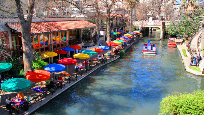 The San Antonio riverwalk and its many colorful sites.