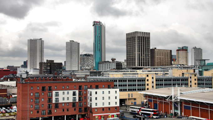 Birmingham skyline with modern office buildings seen from Digbeth. West Midlands, England. Rainy day.