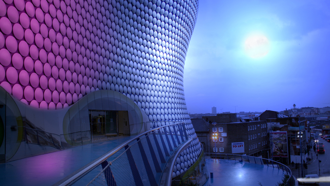 Bullring building and view of birmingham at night by moon light. Famous english architecture.