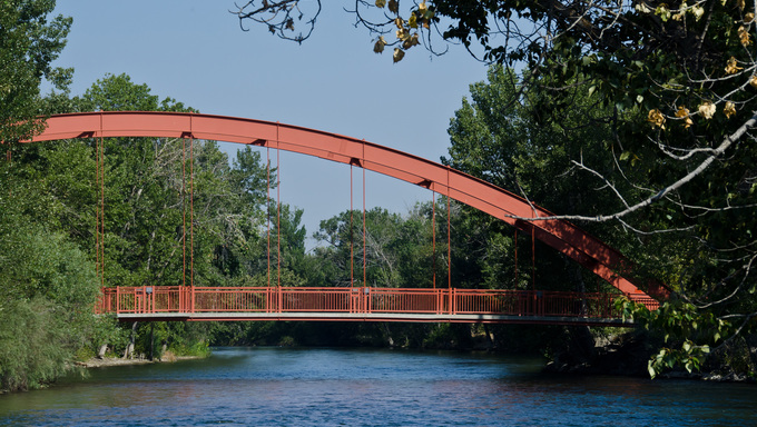 Red Bridge Extending Over the River