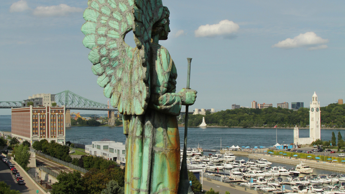 Angel monument and the clock tower in old Montreal, Canada