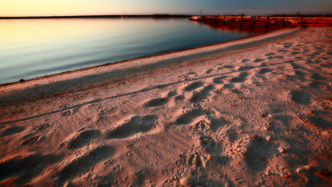 Beach and dock along shore of Lake Winnipeg
