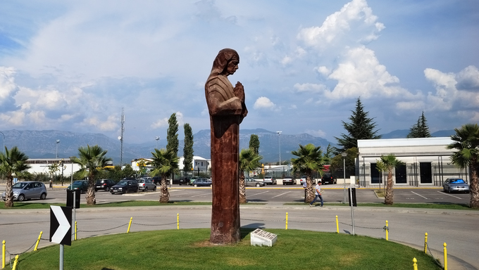 TIRANA, ALBANIA - AUG 14: Statue of Mother Teresa of the sculptor Luan Mulliqi near Tirana International Airport shown on 14th August 2009 in Tirana. This a four-meter bronze sculpture was inaugurated  13.09.2007