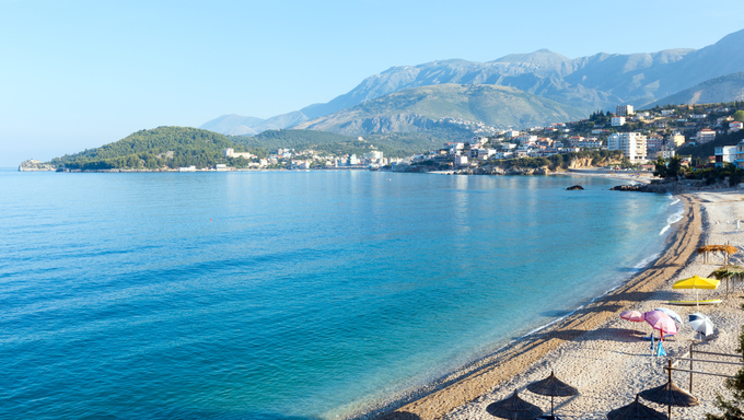 Summer coast morning Himare town view with pebbly beach (Albania)