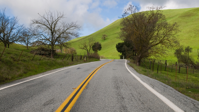Road through green hills, San Jose, California.