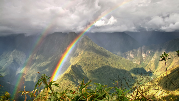 Rainbows in the mountains of Machu Picchu, Cusco, Peru.