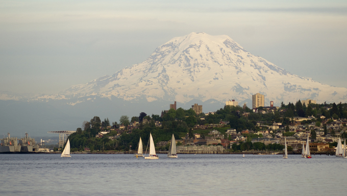 Mt. Rainier looms large over north Tacoma and Sailboats Ruston Way waterfront.