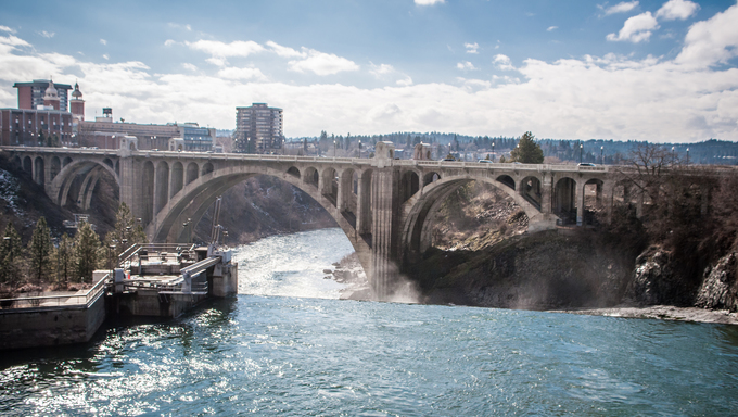 Early evening shot of Spokane River with Spokane Falls. Heritage water power building in background.
