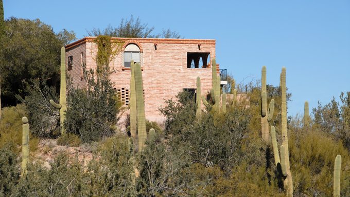 Home surrounded by saguaro cactus, Tucson, Arizona.