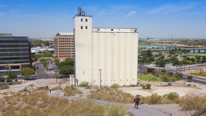 The Hayden Floor Mill in Tempe, Arizona. A father carries his daughters down the Hayden Butte Preserve Trail towards the historic Hayden Flour Mill.