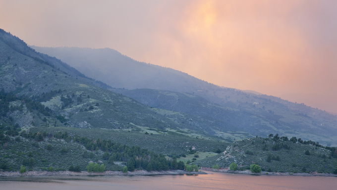 Heavy smoke from High Park wildfire obscuring the sun and sky over Horsetooth Reservoir and foothills near Fort Collins, Colorado.