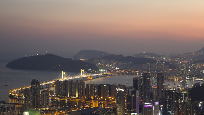 Busan city skyline at sunset.
