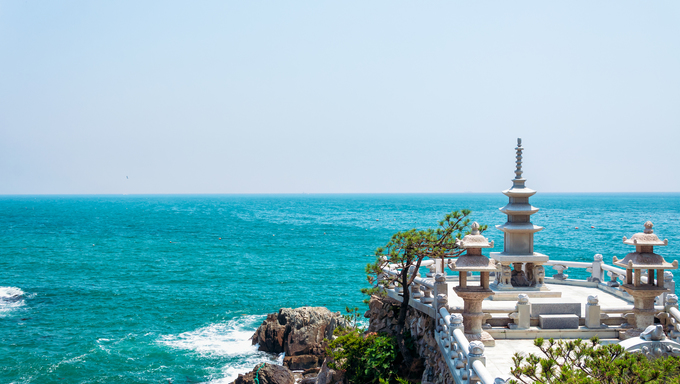 A stone pavilion overlooks the sea at Haedong Yonggungsa Temple in Busan.