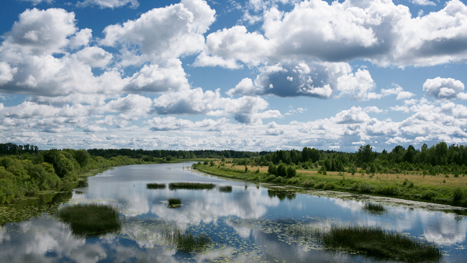 Beauty river under a blue sky with clouds.