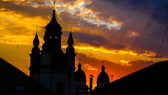 Church in a sunset beams in Lviv, Ukraine. Sunshine church contour