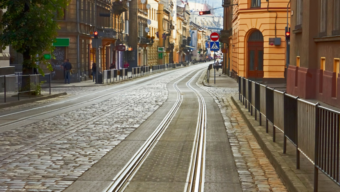 Old cobbled road with tram tracks in the downtown at the morning in Lviv, Ukraine