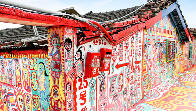 TAICHUNG, TAIWAN - JUL 11: Colorful graffiti dots the walls of the famous Rainbow Village in Taichung July 11, 2013. The village has become a must-see attraction in Taiwan.