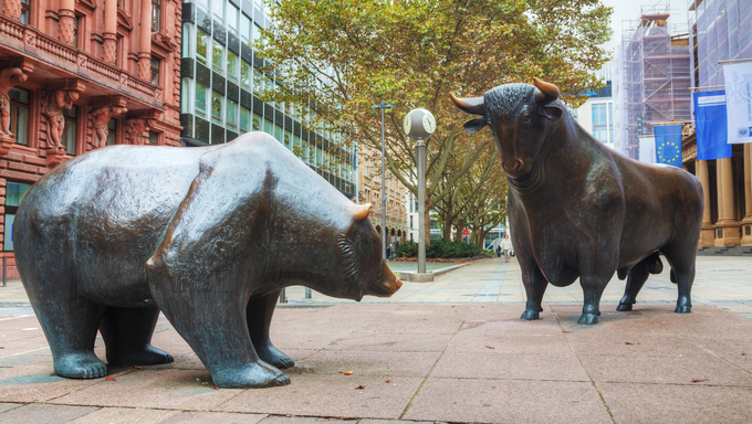 FRANKFURT - OCTOBER 14: Bear and Bull sculpture nearthe Frankfurt Stock Exchange building on October 14, 2014 in Frankfurt, Germany. Frankfurt Stock Exchange is the world's 10th largest stock exchange by market capitalization.