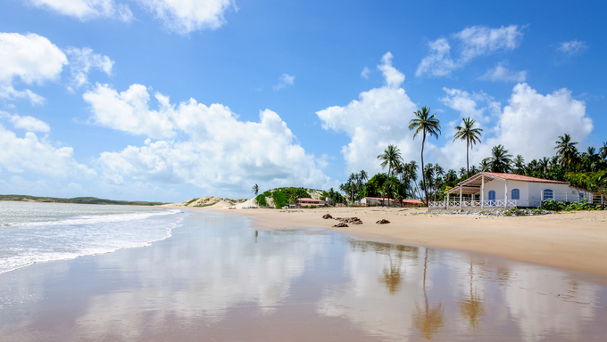 Beach with sand dunes and house, Pititinga, Natal.