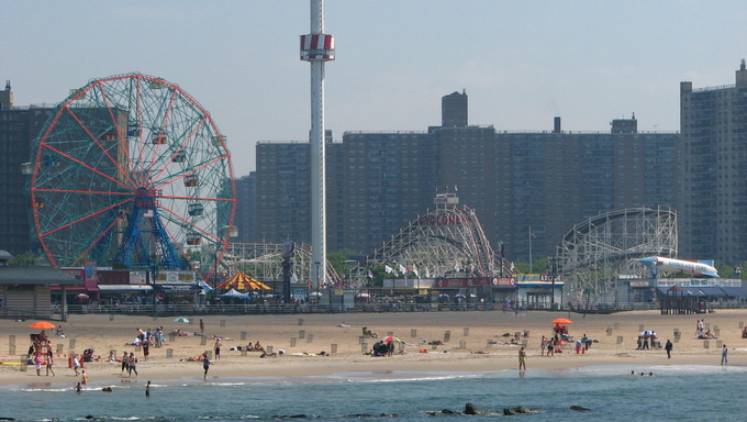 Coney Island is known for its boardwalk restaurants and amusement park is a peninsula and beach on the Atlantic Ocean in southern Brooklyn New York.