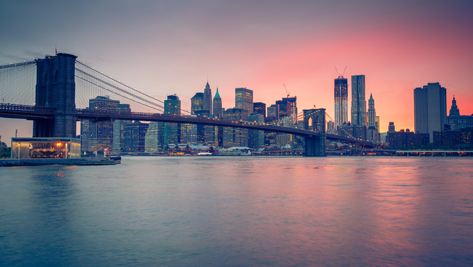 Brooklyn bridge and Manhattan at dusk in New York City.