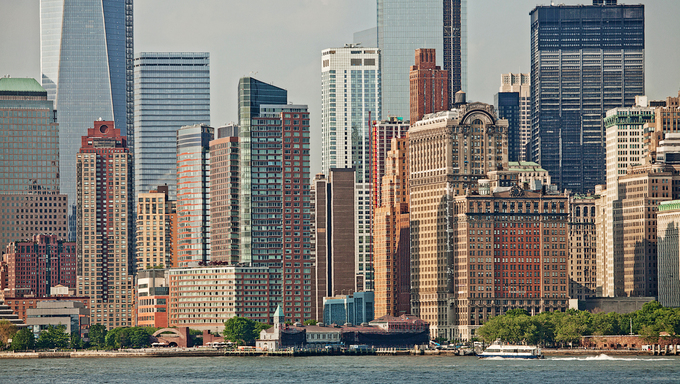 View of the Manhattan skyline taken from the Staten Island ferry as it crosses the Hudson River in New York.