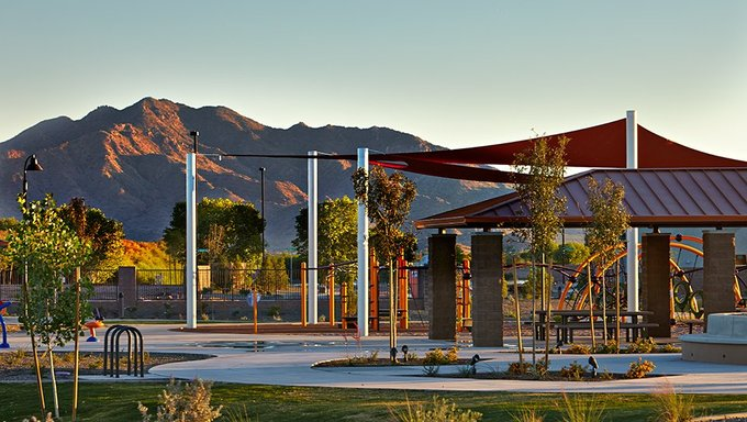 A playground in Gilbert featuring the Arizona mountains.