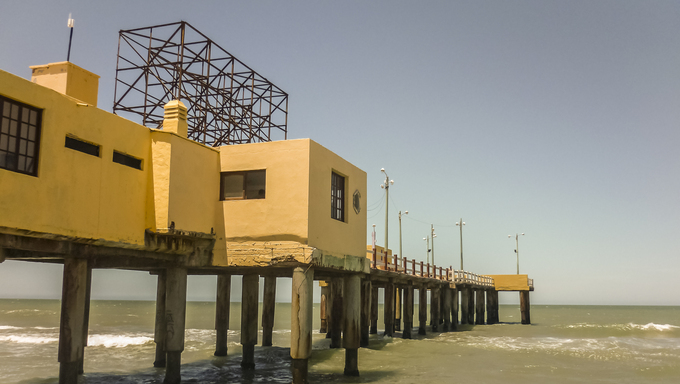 Yellow construction pier with nobody day scene at the beach in the city of Pinamar, a luxury seaside resort of Argentina