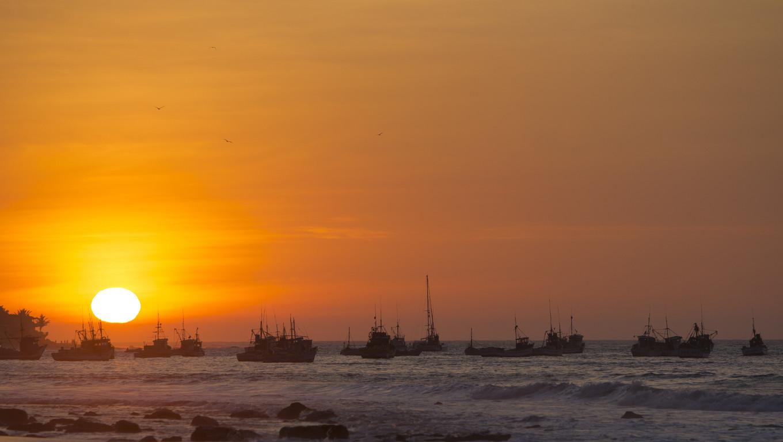 Panorama of the harbor of Manora during a wonderful orange sunset. Peru 2015