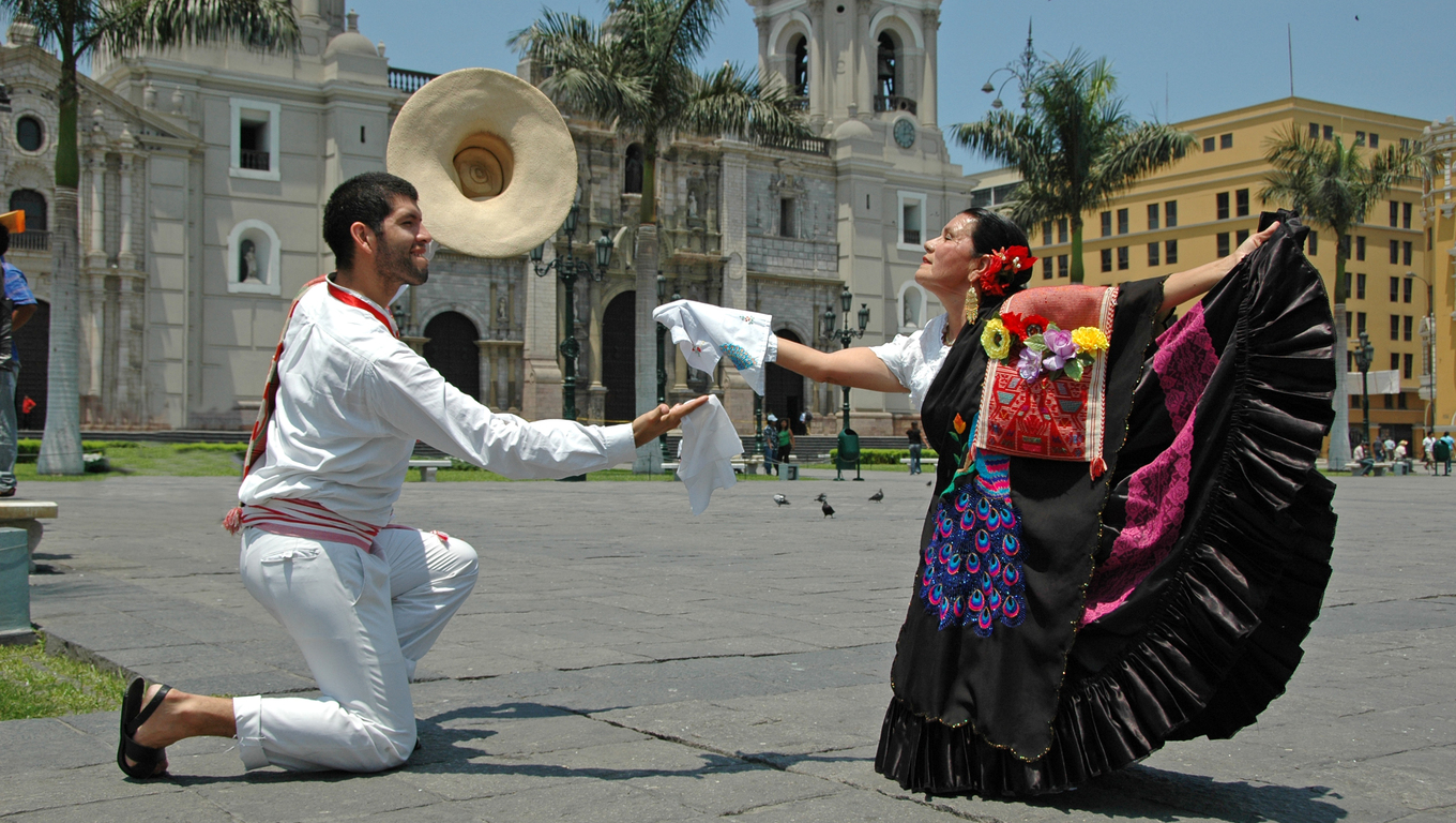 Marinera dancers in front of the cathedral in Lima Peru