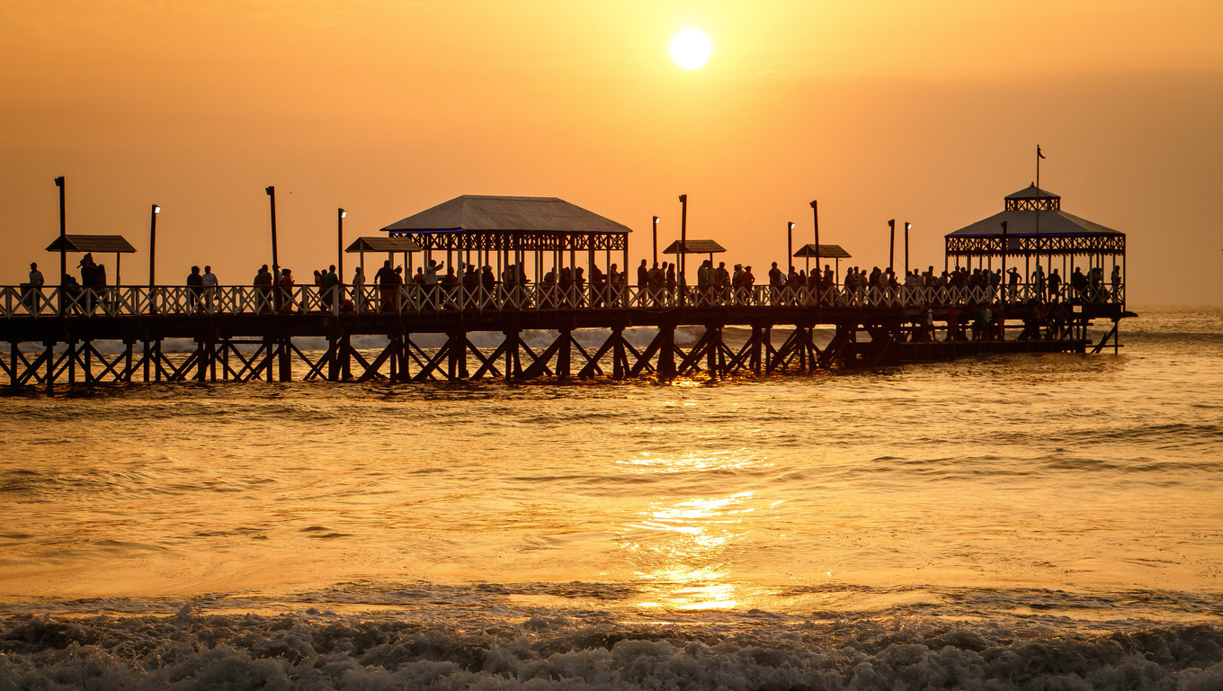 The romantic sunset time at pier of Huanchaco town, neat Trujillo, Peru