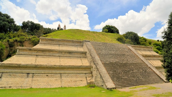 Cholula, the largest pyramid ever build by man looks like a green hill with a church on top near Puebla in Mexico
