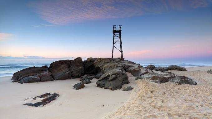 A shark tower on Redhead Beach, a coastal suburb of Lake Macquarie, just before sunrise.