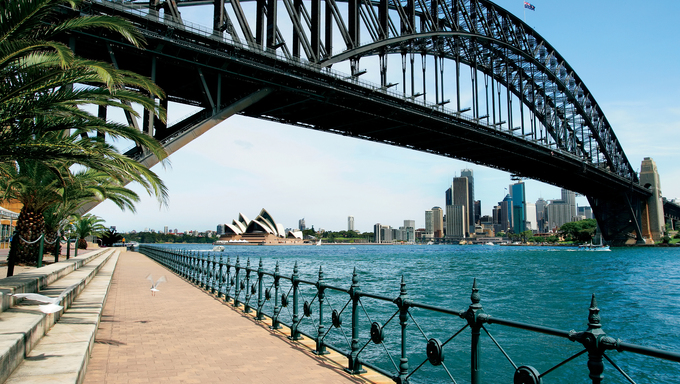 The path that leads beneath Sydney Harbor Bridge in Australia, featuring  the Sydney Cityscape.