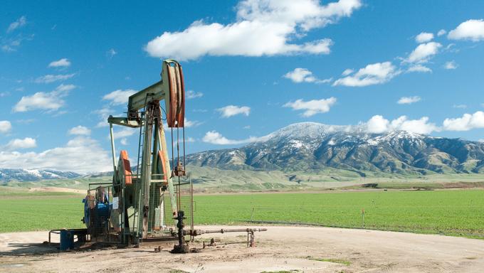 An oil drill in a green field near Bakersfield.