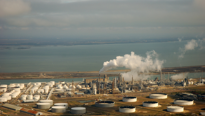 An aerial view of liquid storage tanks on the coast in Corpus Christi.
